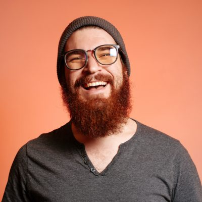 Close,Up,Portrait,Of,Happy,Smiling,Bearded,Hipster,Man,With