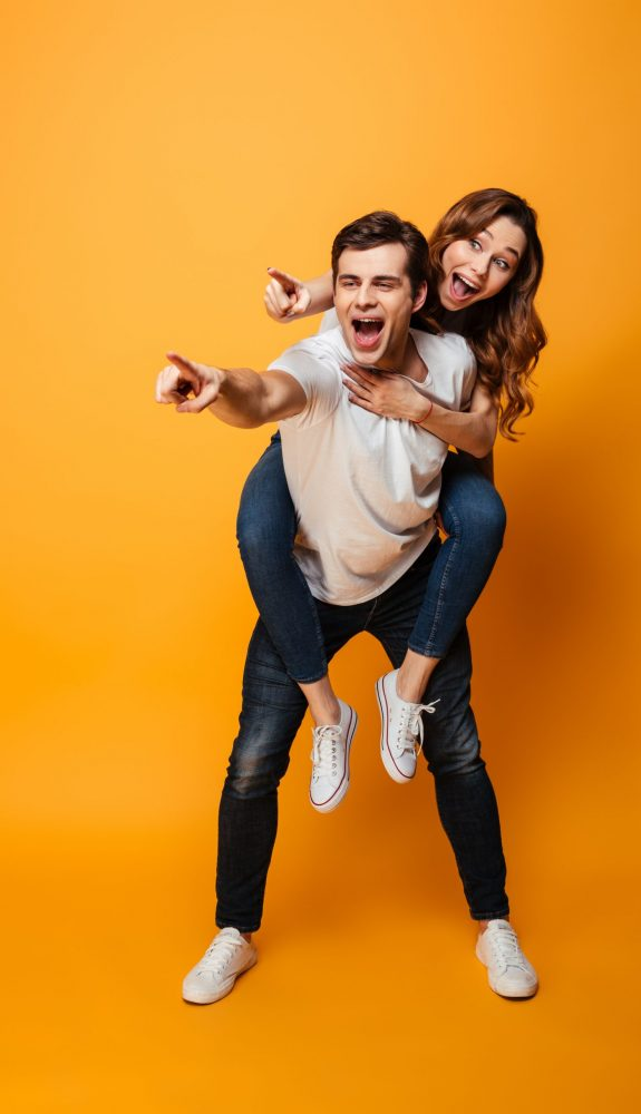 Full,Length,Image,Of,Happy,Young,Lovely,Couple,Having,Fun